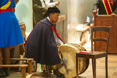 Playing the drum at Mass, Roma, Lesotho